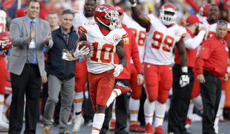 Kansas City Chiefs wide receiver Tyreek Hill scores a touchdown on a punt return during the second half of the team's NFL football game against the San Diego Chargers on Sunday, Jan. 1, 2017, in San Diego. (AP Photo/Rick Scuteri)