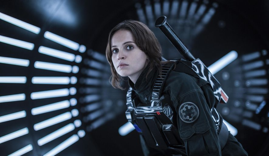 """FILE - This file image released by Lucasfilm Ltd. shows Felicity Jones as Jyn Erso in a scene from, """"Rogue One: A Star Wars Story."""" The """"Star Wars"""" spinoff """"Rogue One"""" has led the box office for the third straight week, taking in an estimated $64.3 million over the four-day New Year's weekend. (Jonathan Olley/Lucasfilm Ltd. via AP, File)"""