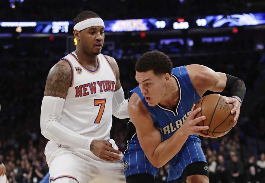 Orlando Magic forward Aaron Gordon (00) is defended by New York Knicks' Carmelo Anthony (7) during the first half of an NBA basketball game Monday, Jan. 2, 2017, in New York. (AP Photo/Frank Franklin II)