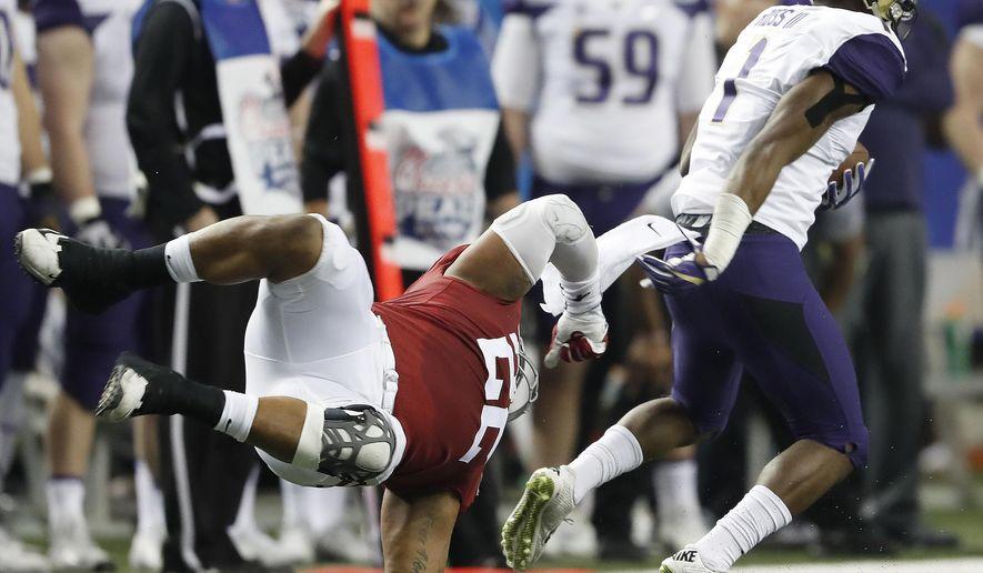 Washington wide receiver John Ross (1) runs past Alabama linebacker Ryan Anderson (22) during the first half of the Peach Bowl NCAA college football playoff game, Saturday, Dec. 31, 2016, in Atlanta. (AP Photo/John Bazemore)