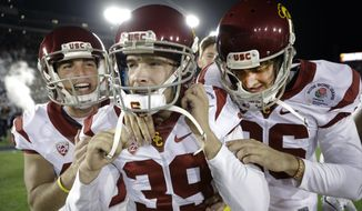 Southern California place kicker Matt Boermeester, middle, celebrates after the game winning field goal against Penn State during the second half of the Rose Bowl NCAA college football game Monday, Jan. 2, 2017, in Pasadena, Calif. (AP Photo/Jae C. Hong) ** FILE **