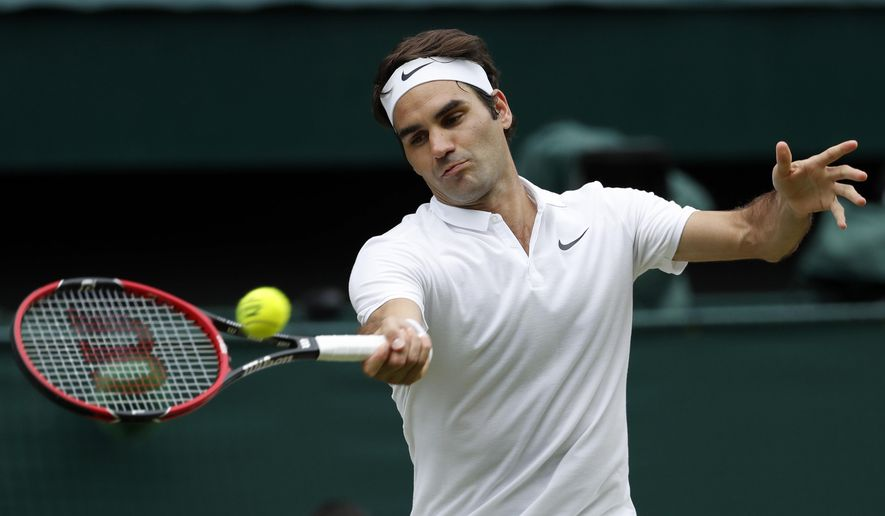FILE - In this July 8, 2016, file photo, Roger Federer of Switzerland returns to Milos Raonic of Canada during their men's semifinal singles match at the Wimbledon Tennis Championships in London. Federer returned from six months on the sidelines with a knee injury to beat Dan Evans 6-3, 6-4 on Monday, Jan. 2, 2017 and lead Switzerland to an opening win over Britain at the Hopman Cup mixed teams tournament. (AP Photo/Ben Curtis, File)