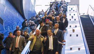 FILE - In this Jan. 1, 2017 file photo, MTA Chairman and CEO Thomas Prendergast, second right, and New York Gov. Andrew Cuomo, right, enter the newly opened 96th Street station of the Second Ave. subway along with riders in New York. Gov. Andrew Cuomo said Monday, Jan. 2, that Prendergast will retire early this year. (AP Photo/Craig Ruttle, File)
