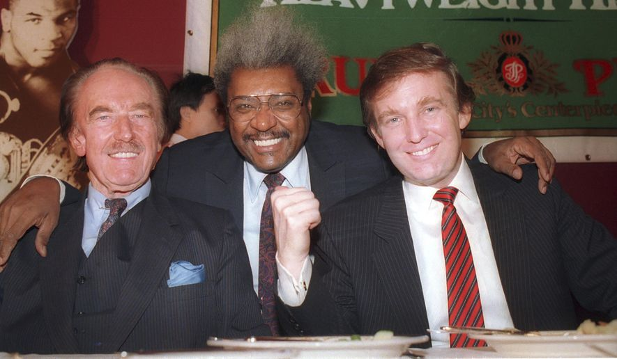 """In this December 1987 file photo, Donald Trump, right, pictured with his father, Fred Trump, left, and boxing promoter Don King participate in news conference in Atlantic City, N.J. Many of President-elect Donald Trump's cultural touchstones, which he'd frequently namedrop at campaign rallies and on Twitter, including Don King, were at their peak in the 1980s, the decade that Trump's celebrity in New York rose, Trump Tower was built, """"The Art of the Deal"""" was published and he first flirted with running for public office. (AP Photo/File)"""