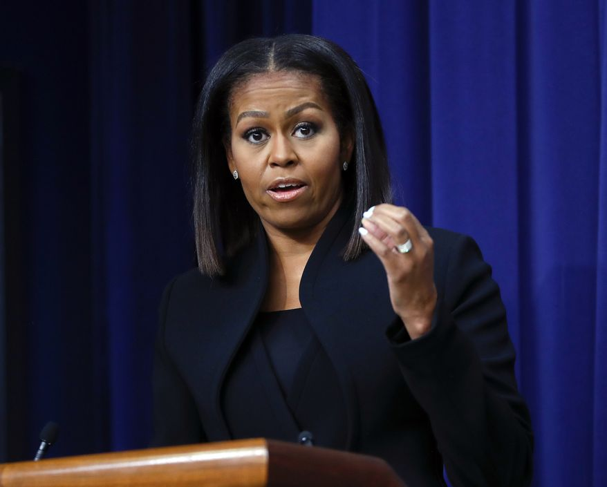 In this Dec. 15, 2016, file photo, first lady Michelle Obama speaks after the screening for the movie 'Hidden Figures,' in the South Court Auditorium in the Eisenhower Executive Office Building on the White House complex in Washington. When Obama helps recognize the school counselor of the year on Friday, Jan. 6, aides say it will also mark her final public event as first lady.(AP Photo/Pablo Martinez Monsivais, file)