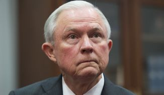 """The organization held the demonstration to protest Sen. Jeff Sessions' nomination by President-elect Donald Trump, saying Sessions has a questionable record on civil rights and """"can't be trusted to be the chief law enforcement officer for voting rights."""" (Associated Press)"""