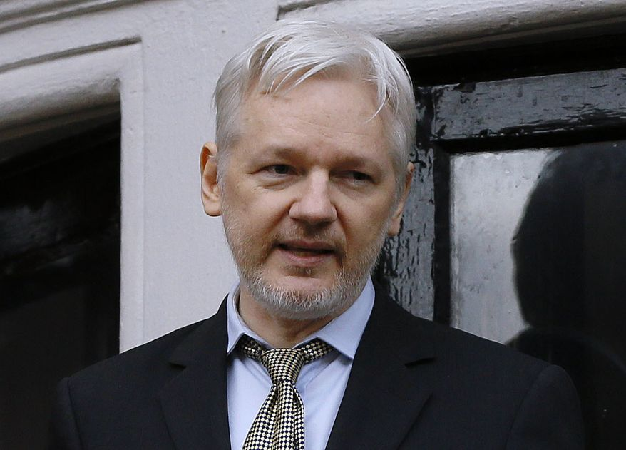 In this Friday Feb. 5, 2016, file photo, WikiLeaks founder Julian Assange speaks from the balcony of the Ecuadorean Embassy in London. (AP Photo/Kirsty Wigglesworth, File)