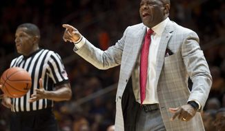 Arkansas head coach Mike Anderson yells at his players during the first half of an NCAA college basketball game against Tennessee in Knoxville, Tenn., Tuesday, Jan. 3, 2017. (Brianna Paciorka/Knoxville News Sentinel via AP)