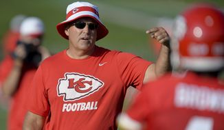 FILE - In this Aug. 2, 2015, file photo, Kansas City Chiefs special teams coach Dave Toub talks with receiver DaRon Brown during NFL football training camp in St. Joseph, Mo. Andy Reid has called Toub the best special teams coach in the NFL. His work in Kansas City this year has done nothing to disprove it. But the downside to it? Toub could soon be a head coach somewhere, and leave Reid looking for a replacement. (Andrew Carpenean/The St. Joseph News-Press via AP, File)