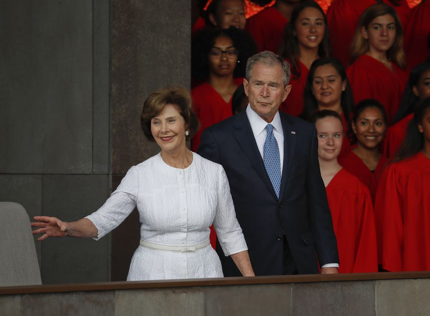In this photo taken Sept. 24, 2016, former President George W. Bush and former first lady Laura Bush are seen in Washington. (AP Photo/Pablo Martinez Monsivais, File)