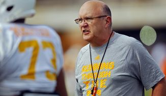FILE -- In this April 9, 2015, file photo, Tennessee offensive coordinator Mike DeBord directs players during NCAA college football practice in Knoxville, Tenn. A person with knowledge of the decision tells The Associated Press that new Indiana coach Tom Allen will hire Mike DeBord as offensive coordinator.  The person spoke to the AP on condition of anonymity Tuesday, Jan. 3, 2017,  because an official announcement has not yet been made. (Wade Payne//Knoxville News Sentinel via AP, File)