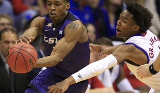 Kansas State guard Barry Brown (5) is covered by Kansas guard Devonte' Graham during the first half of an NCAA college basketball game in Lawrence, Kan., Tuesday, Jan. 3, 2017. (AP Photo/Orlin Wagner)