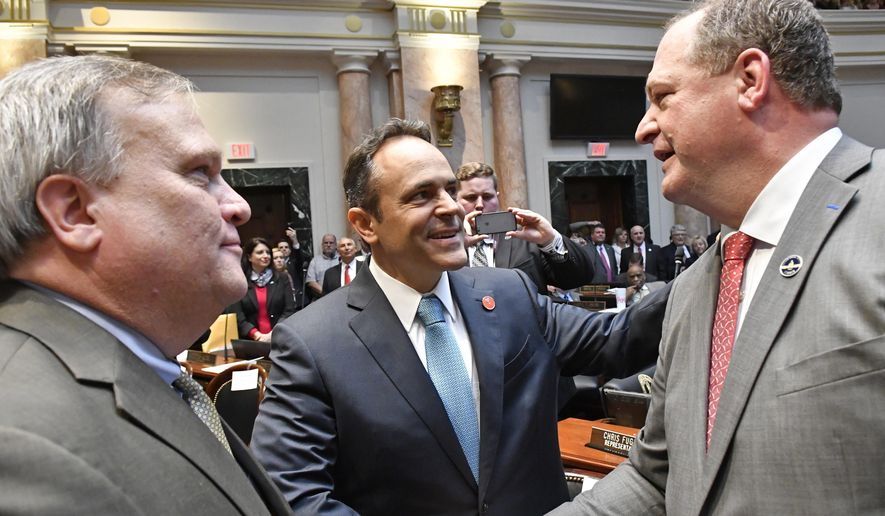 In this Jan. 3, 2017 file photo, Kentucky Gov. Matt Bevin, center, and Kentucky Senate President Robert Stivers, left, congratulate Jeff Hoover following his being voted in as Speaker of the House. (AP Photo/Timothy D. Easley) **FILE**