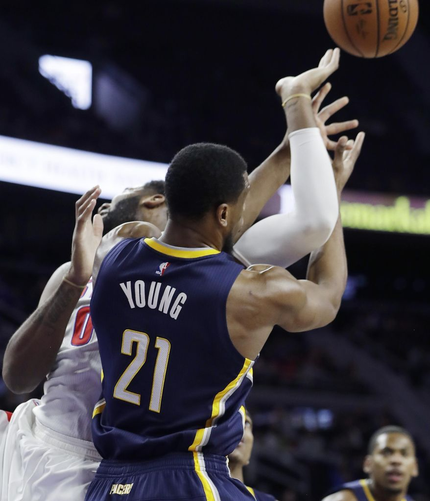 Detroit Pistons center Andre Drummond fouls Indiana Pacers forward Thaddeus Young (21) during the first half of an NBA basketball game, Tuesday, Jan. 3, 2017, in Auburn Hills, Mich. (AP Photo/Carlos Osorio)
