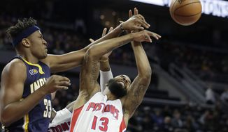 Indiana Pacers center Myles Turner (33) and Detroit Pistons forward Marcus Morris (13) reach for the rebound during the first half of an NBA basketball game, Tuesday, Jan. 3, 2017, in Auburn Hills, Mich. (AP Photo/Carlos Osorio)