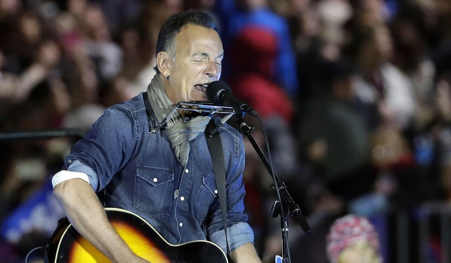 Bruce Springsteen performs during a Hillary Clinton campaign event at Independence Mall in Philadelphia on Nov. 7, 2016. (Associated Press) **FILE**