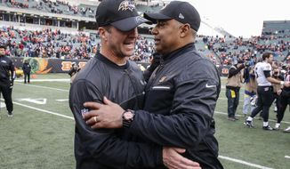 Baltimore Ravens head coach John Harbaugh, left, and Cincinnati Bengals head coach Marvin Lewis meet after an NFL football game, Sunday, Jan. 1, 2017, in Cincinnati. The Bengals won 27-10. (AP Photo/Gary Landers)