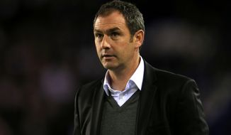 FILE - In this Aug. 21, 2015 file photo, Paul Clement stands on the touchline, in Birmingham, England. Swansea has hired Paul Clement as its third manager of the season as the club tries to stay in the English Premier League, it was announced on Tuesday, Jan. 3, 2017. (Nick Potts/PA via AP, File)