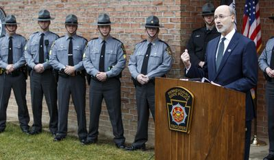 Pennsylvania Gov. Tom Wolf speaks at the State Police Huntingdon Barrack at the State Police Huntingdon Barracks in Huntingdon, Pa., Monday, Jan.2, 2017, after Trooper Landon Weaver, 23, who was stationed at the barracks, was killed while investigating a reported violation of a protection from abuse order Friday night. State police shot and killed the suspect in Weaver's death after an overnight manhunt. (Dan Gleiter/PennLive.com via AP)