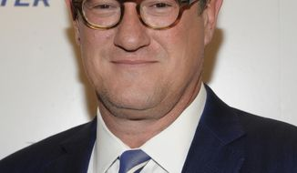 """FILE - In this April 11, 2012 file photograph taken by AP Images for The Hollywood Reporter, 'Morning Joe' host Joe Scarborough arrives at The Hollywood Reporter 35 Most Powerful People in Media event in New York. On """"Morning Joe"""" Tuesday, Scarborough reiterated his stance that he didn't attend a New Year's Eve party at President-elect Donald Trump's Mar-A-Lago estate in Florida despite a photo that appeared to show him standing with Trump near revelers.(Evan Agostini/AP Images for The Hollywood Reporter, File)"""