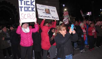 This Oct. 10, 2016 photo shows striking union members picketing outside the Trump Taj Mahal casino in Atlantic City N.J. moments before it shut down. Owner Carl Icahn plans to surrender the casino license for the shuttered facility, and has filed a deed restriction against the property preventing any future buyer from using it as a casino unless they pay an unspecified fee. (AP Photo/Wayne Parry)