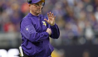 FILE - In this Sunday, Jan. 1, 2017, file photo, Minnesota Vikings head coach Mike Zimmer directs his team during the first half of an NFL football game against the Chicago Bears in Minneapolis. Zimmer watched his team surrender the NFC North title back to rival Green Bay and squander a 5-0 start, putting the pressure on the 60-year-old to steer the team back into the playoffs next season.  (AP Photo/Andy Clayton-King, File)