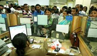 Indians deposited discontinued notes on the last day in a bank in Gauhati, India. Prime Minister Narendra Modi yanked most of its currency bills from circulation without warning, delivering a jolt to the country's high-performing economy and leaving countless citizens scrambling for cash. (Associated Press)