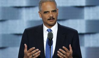 This July 26, 2016, file photo former Attorney General Eric Holder speaks during the second day of the Democratic National Convention in Philadelphia. Vowing to protect California's values and constitutional guarantees, the state Legislature has selected Holder to serve as outside counsel to advise the legal strategy against the incoming Trump administration. (AP Photo/J. Scott Applewhite, File)
