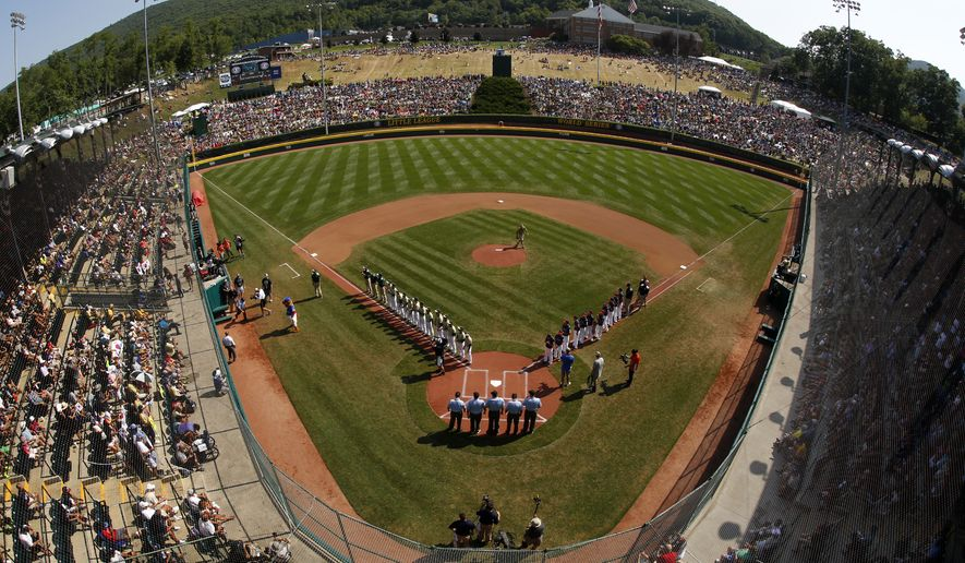 FILE - In this Aug. 28, 2016, file photo, taken with a fisheye lens, South Korea lines the third baseline and Endwell, N.Y. lines the first baseline during team introductions before the Little League World Series Championship baseball game at Lamade Stadium in South Williamsport, Pa. Little League International announced mandatory criminal background checks for its volunteer coaches, new eligibility requirements for players and a host of new rules on Wednesday, Jan. 4, 2017, intended to increase the pace of play.  (AP Photo/Gene J. Puskar, File)