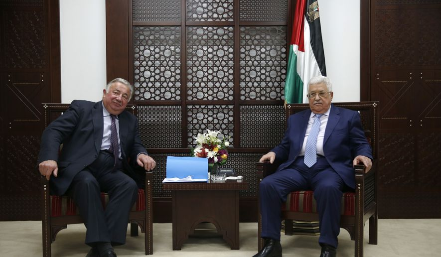 President Mahmoud Abbas, right, meets with the President of the Senate of France Gerard Larcher, at the Palestinian president's office in the West Bank city of Ramallah, Wednesday, Jan. 4, 2017. (AP Photo/Majdi Mohammed)