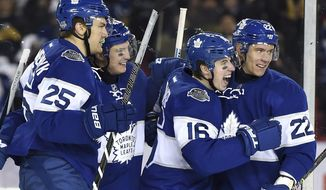 FILE - In this Jan. 1, 2017 file photo, Toronto Maple Leafs center Mitch Marner (16) celebrates his goal with teammates James van Riemsdyk (25), Tyler Bozak (42) and Nikita Zaitsev (22) during the third period of the NHL Centennial Classic hockey game in Toronto. The franchise is celebrating its 100th year while also trying to move past half a century without a championship. And what better way to do so than to bring back the old guard, including members of the 1967 team, the last Maple Leafs squad to win a Stanley Cup. George Armstrong, Dave Keon, Johnny Bower - meet Marner, Auston Matthews, William Nylander and company. (Frank Gunn/The Canadian Press via AP, File)