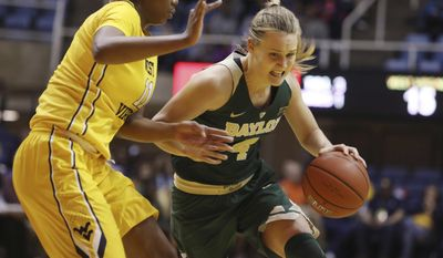 Baylor guard Kristy Wallace (4) drives to the basket while being defended by West Virginia forward Teana Muldrow (11) during the first quarter of an NCAA college basketball game, Wednesday, Jan. 4, 2017, in Morgantown, W.Va. (AP Photo/Raymond Thompson)