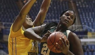 West Virginia center Lanay Montgomery (15) attempts to block Baylor center Kalani Brown (21) shot during the first half quarter of an NCAA college basketball game, Wednesday, Jan. 4, 2017, in Morgantown, W.Va. (AP Photo/Raymond Thompson)