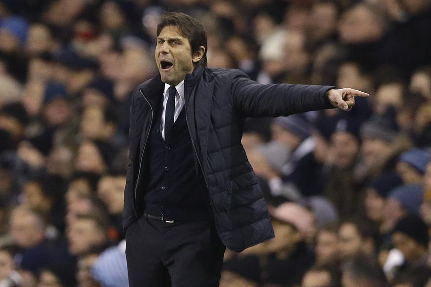 Chelsea's manager Antonio Conte shouts during the English Premier League soccer match between Tottenham Hotspur and Chelsea at White Hart Lane stadium in London, Wednesday, Jan. 4, 2017. (AP Photo/Alastair Grant)