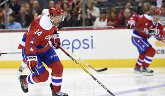 "In this Nov. 18, 2016, file photo, Washington Capitals right wing Justin Williams (14) skates with the puck during the third period of an NHL hockey game against the Detroit Red Wings in Washington. After two points in his first 15 games, Washington Capitals winger Justin Williams has nine goals and eight assists in his past 22 and has ""still got it,"" according to Alex Ovechkin,  (AP Photo/Nick Wass, File0  **FILE**"