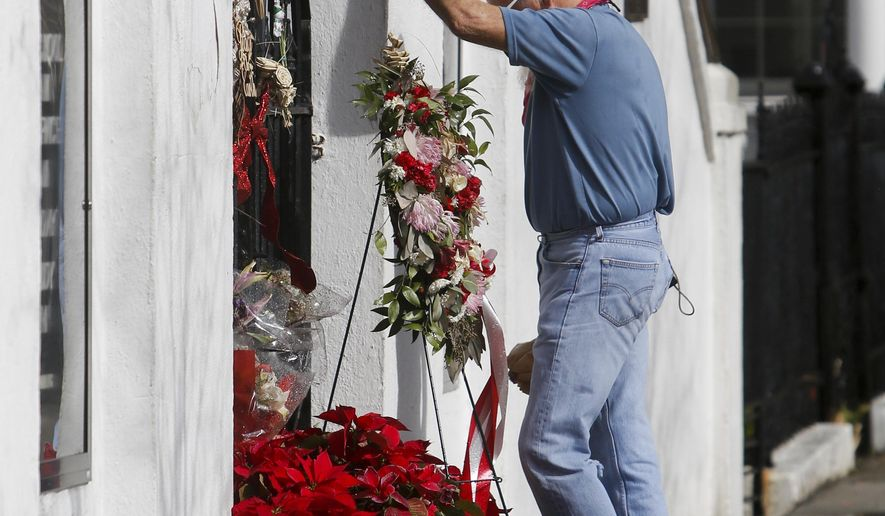 "John Johnson pays his respects at the Emanuel African Methodist Episcopal Church in Charleston, S.C., Tuesday, Jan. 3, 2017. Johnson was visiting from Ocean City, Md., and made the church a destination for the day. ""We just came to pay our respects,"" he said, ""I feel like we had to do something."" Dylann Roof went into Emanuel African Methodist Episcopal Church on June 17, 2015, sat through a 45-minute Bible study in the fellowship hall, then fired 77 shots. After a judge ruled Monday that Roof is competent to represent himself, the same jury that last month unanimously found him guilty in the slayings of nine black parishioners at the church will return to court to begin contemplating his punishment. (Michael Pronzato/The Post And Courier via AP)"