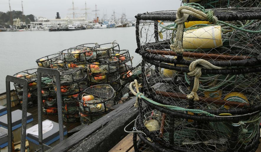 Crab pots sit on a processing pier and the back of a boat at Fisherman's Wharf Tuesday, Jan. 3, 2017, in San Francisco. Dungeness crab could be harder to come by if fishers from Canada to Northern California continue their strike over the purchase price. The strike started December 28 after Pacific Choice Seafood in Humboldt County, California, offered to pay $2.75 a pound for the tasty crustacean. Crabbers whose seasons had already opened had negotiated a price of $3 per pound. (AP Photo/Eric Risberg)