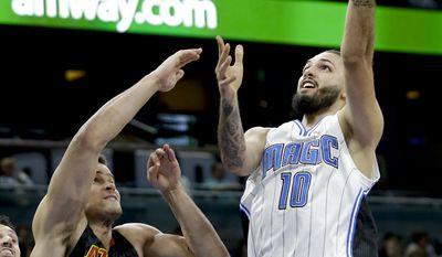 Orlando Magic's Evan Fournier (10) shoots over Atlanta Hawks' Kris Humphries (43) during the first half of an NBA basketball game, Wednesday, Jan. 4, 2017, in Orlando, Fla. (AP Photo/John Raoux)