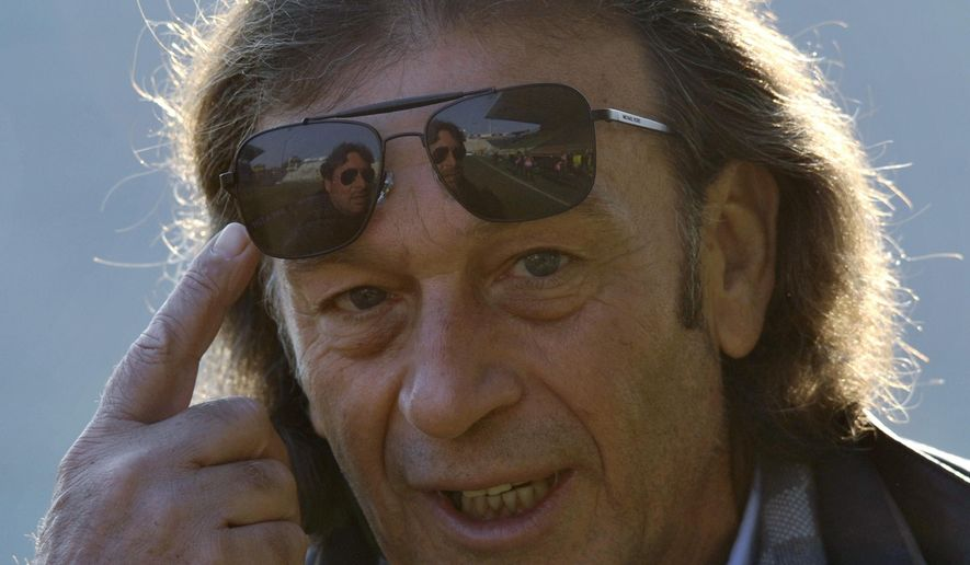 FILE - In this Sunday, Dec. 15, 2013 file photo the then Cagliari president Massimo Cellino gestures prior to the Serie A soccer match between Parma and Cagliari at Parma's Tardini stadium.  Owner of English soccer club Leeds United, Massimo Cellino has sold half of the club to fellow Italian Andrea Radrizzani, according to a statement released by Leeds United Wednesday Jan. 4, 2017. (AP Photo/Marco Vasini, FILE)