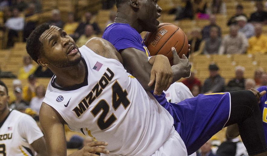 Missouri's Kevin Puryear, left, gets tangled up with LSU's Duop Reath, right, as they battle for a rebound during the second half of an NCAA college basketball game, Wednesday, Jan. 4, 2017, in Columbia, Mo. LSU won the game 88-77. (AP Photo/L.G. Patterson)