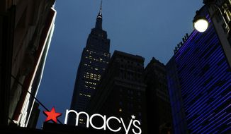 File- This Sept. 17, 2016, file photo shows a Macy's sign being illuminated on a store marquis, in New York. Macy's says it is eliminating more than 10,000 jobs and plans to move forward with 68 store closures after a disappointing holiday shopping season. The department store chain also lowered its full-year earnings forecast.(AP Photo/Mark Lennihan)