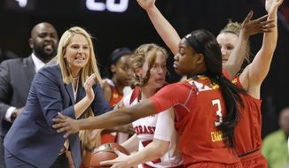 Maryland coach Brenda Frese, left, follows from the sidelines as Nebraska's Hannah Whitish (3) is cut off by Maryland's Kaila Charles (3) and Kristen Confroy, right, during the first half of an NCAA women's college basketball game in Lincoln, Neb., Wednesday, Jan. 4, 2017. (AP Photo/Nati Harnik)