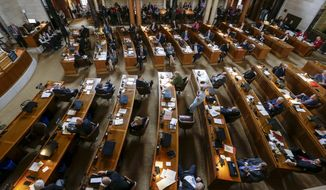 Senators sit at their desks on the first day of the 2017 legislative session, in Lincoln, Neb., Wednesday, Jan. 4, 2017. The Legislature convenes for a 90-day session that could be dominated by budget choices due to an expected revenue shortfall. (AP Photo/Nati Harnik)