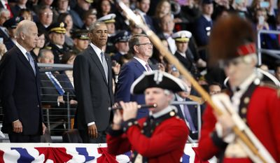"President Barack Obama, with Vice President Joe Biden and Defense Secretary Ash Carter, watches the Old Guard Fife and Drum Corps perform a ""Troops In Review,"" during an Armed Forces Full Honor Farewell Review for the president, Wednesday, Jan. 4, 2017, at Conmy Hall, Joint Base Myer-Henderson Hall, Va. (AP Photo/Alex Brandon)"