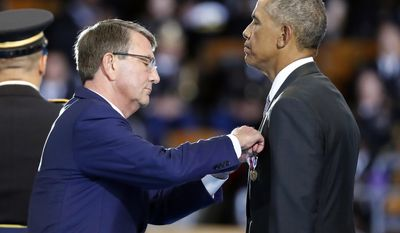 Defense Secretary Ash Carter pins the Department of Defense for Distinguished Public Service on President Barack Obama during an Armed Forces Full Honor Farewell Review for the president, Wednesday, Jan. 4, 2017, at Conmy Hall, Joint Base Myer-Henderson Hall, Va. (AP Photo/Alex Brandon)