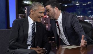 """Jimmy Kimmel speaks with then-President Obama in between taping segments of """"Jimmy Kimmel Live!"""" at the El Capitan Entertainment Center in Los Angeles, Oct. 24, 2016. (AP Photo/Susan Walsh) ** FILE **"""
