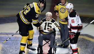 FILE - In this Oct. 20, 2016, file photo, Boston Bruins defenseman Zdeno Chara (33) and New Jersey Devils defenseman Andy Greene (6) participate with Bruins legends Milt Schmidt (15) and Bobby Orr in a ceremonial puck drop before an NHL hockey game in Boston. Schmidt, a hockey hall of famer, has died at the age of 98, Bruins team spokesman Matt Chmura said Wednesday, Jan. 4, 2017. Schmidt, the NHL MVP in 1951, was the league's oldest living former player. (AP Photo/Elise Amendola, File)