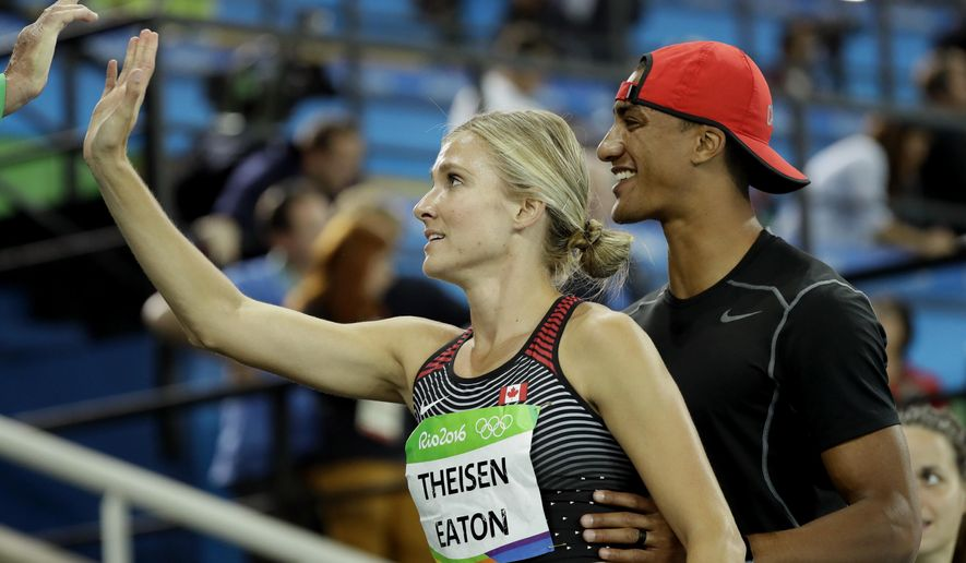 FILE - In this Aug. 13, 2016, file photo, Canada's Brianne Theisen Eaton is greeted by husband Ashton Eaton, right, after the women's heptathlon 800-meter heat during the athletics competitions of the 2016 Summer Olympics at the Olympic stadium in Rio de Janeiro, Brazil. Two-time Olympic decathlon gold medalist Ashton Eaton and heptathlete Brianne Theisen-Eaton have announced their retirements, Wednesday, Jan. 4, 2017, in side-by-side essays on their website. Considered the first family of multi-events, the couple met at the University of Oregon as teenagers and married in July 2013. (AP Photo/David J. Phillip, File)