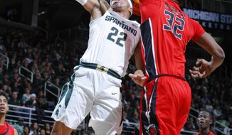 Michigan State's Miles Bridges (22) goes to the basket against Rutgers' Ibrahima Diallo (32) during the first half of an NCAA college basketball game, Wednesday, Jan. 4, 2017, in East Lansing, Mich. (AP Photo/Al Goldis)