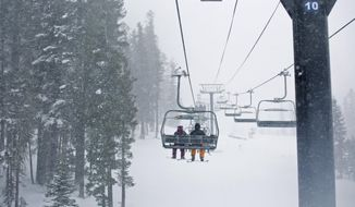 In this photo provided by Northstar California, skiers enjoy the view while riding on the Vista Express at the Northstar California resort in Truckee, Calif., Tuesday, Jan. 3, 2017. The Sierra Avalanche Center has issued an avalanche warning for the mountains around Lake Tahoe after a winter storm dumped nearly 2 feet of snow on area ski resorts.  (Northstar California via AP)